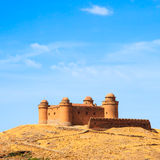 Castle on hill, Castillo de La Calahorra and village, Granada, A Stock Images