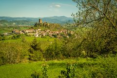 Castle on a hill with its village. In the summer in France royalty free stock image
