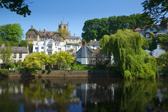Castle on hill in Knaresborough, Yorkshire, UK. Caste and village on the bank of river Nidd in Knaresborough, taken in bright summer sunlight in the Mother Royalty Free Stock Image