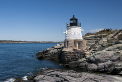Castle Hill lighthouse in Newport, Rhode Island. Castle Hill lighthouse has a unique architecture constructed on rocky shore near Newport, Rhode island royalty free stock photo