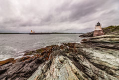 Castle Hill Lighthouse in Newport, Rhode Island, situated on a dramatic rocky coastline stock image