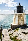 Castle hill lighthouse by the ocean in Newport Rhode Island. A picture of castle hill lighthouse by the ocean in Newport Rhode Island stock photo