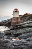 Castle Hill Lighthouse Reflection. Long exposure of Castle Hill Lighthouse seascape in the morning with a beacon reflection in the water royalty free stock image