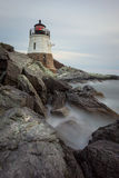 Castle Hill Lighthouse at Sunset. This is a long exposure vertical image of Castle Hill Lighthouse at sunset in Newport, Rhode Island, USA stock photo