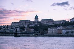 Castle Hill at the sunset, Budapest. Castle Hill with the Matthias Church, the Fisherman`s Bastion, and the Danube River, Budapest, Hungary royalty free stock photography