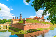 Castle on the hill and a moat around it Stock Images