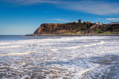Castle Hill from North Bay. Scarborough is a town on the North Sea coast of North Yorkshire.  Castle Hill separates the seafront into two bays to the North and Royalty Free Stock Photography