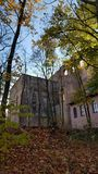 Castle on hill. Castle hill  outside  forest autumn stock photo