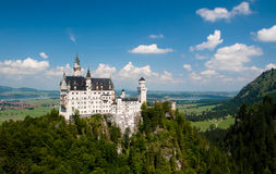 Castle on a hill with a view. Bavarian castle Neuschwanstein in a summer stock images