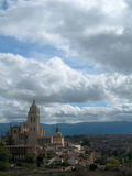 Castle on hilltop and city against cloudy sky. In Spain royalty free stock images