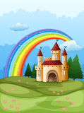 A castle at the hilltop with a rainbow Stock Image