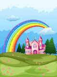 A castle at the hilltop with a rainbow in the sky Stock Images