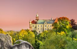 Castle on the hilltop surrounded by autumn coloured trees Royalty Free Stock Photo