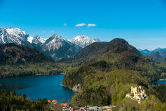 Castle Hohenschwangau with lake and europe alps in background Stock Photo