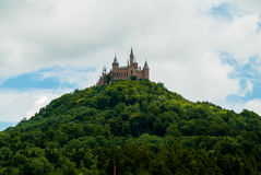 Castle Hohenzollern on the green hill Stock Photo