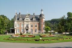 Castle of Huizingen (family park). Castle of Huizingen and floral composition Stock Images