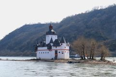 Castle inclosed by the river rhine stock photo