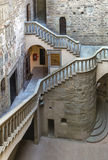 Castle indoor. The interior with the great stairs of a medieval castle in Italy. The building is in the public domain Royalty Free Stock Photography