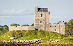 Castle in Ireland. An old Castle in Ireland on a green grass hill Royalty Free Stock Photography