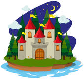 Castle on island at night Royalty Free Stock Image