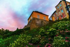 Castle Jansky hill with blossoming hillside. Castle Jansky hill with blooming hillside in colorful sunset in summer. Town Javornik, Czech republic royalty free stock photo