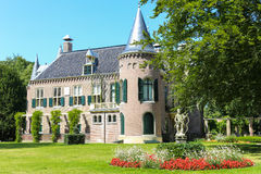 Castle Keukenhof, Lisse. Castle Keukenhof and green garden with statue, Lisse, The Netherlands stock photo
