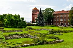 The castle in Krakow Poland. The brown castle stay on the hill in Krakow Poland stock photography