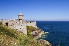Castle of La Latte in the northeast of Brittany. Fort la Latte is located on a peninsula and the only access to the fort is via the drawbridge Royalty Free Stock Photo