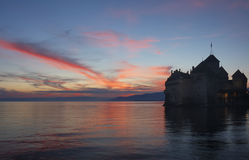 The castle by the lake. The Chateau de Chillon, on Lac Leman (Lake Geneva) at sunset Stock Images