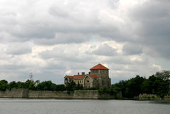 Castle by the lake. Castle of Tata,Hungary nearby the Old-lake Royalty Free Stock Photos