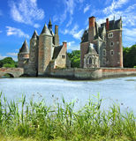 Castle and lake on a background of the blue sky. Royalty Free Stock Images