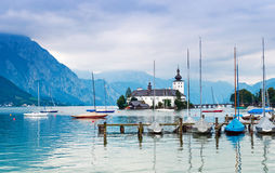 Castle on the lake. Island Castle Orth. Salzkammer Royalty Free Stock Image