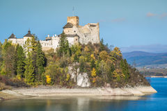 Castle on the lake in Niedzica, Poland.  stock photography