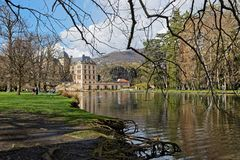 Castle, lake and park of Vizille. VIZILLE, FRANCE, March 31, 2018 : Chateau de Vizille is one of the most prestigious castles of the Dauphine Region. Today the Stock Photos
