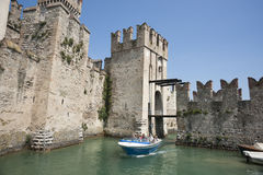 Castle on a lake. Stock Images