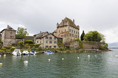 Castle by the lake in Yvoire. Yvoire, France - May 24, 2013: Medieval castle that is beautifully situated on the shore of Lake Geneva. Other stone houses in the Stock Image