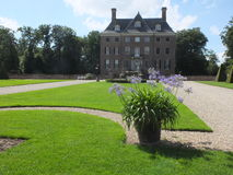 Castle and lawn. Castle in Denmark with a sculptured lawn in front Stock Images