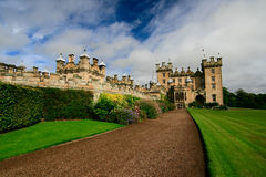 Castle with lawn. Castle with a green lawn in the summer Royalty Free Stock Images