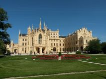 Castle Lednice and part of its garden in summer day with blue sky stock image
