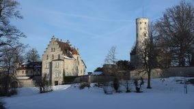 Castle Lichtenstein, Germany. Establishing shot from the south side of castle Lichtenstein in Swabia, Germany, bathed in stunningly beautiful early morning light stock video footage