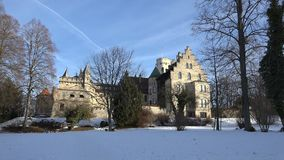 Castle Lichtenstein, Germany. South side view of castle Lichtenstein in Swabia, Germany, bathed in stunningly beautiful early morning light on a cold winter`s stock footage
