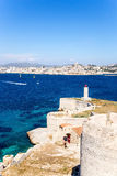 Castle and lighthouse on the island of If. In the background, Marseille, France Royalty Free Stock Image