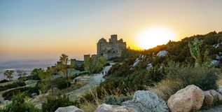 Medieval castle of Loarre at dusk with sun, wide panorama Stock Photo
