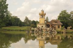 Yellow castle in lake stock photos