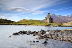 Castle on loch Royalty Free Stock Photos