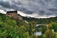 Castle Loket. In the Northern Czech Republic is on the rock above the river Ohre. In this case we thanks to HDR see a cloudy weather before the storm Stock Images