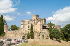 Castle of Lourmarin and car parking Royalty Free Stock Photography