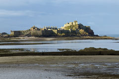 Castle at low tide stock photos