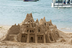 Castle made of sand on beach. In Buzios, Brazil Stock Photos
