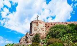 The castle Malaspina above the village of Bosa on a sunny day - Sardinia. Ancient, antique, architecture, bricks, buildings, cross, effect, facade, hill royalty free stock photography